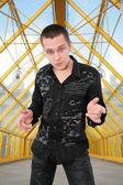 Boy in black shirt on pedistrian bridge — Stock Photo