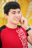 Young man talks by cell phone on yellow footbridge — Stock Photo