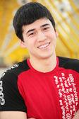 Smiling young man on footbridge — Stock Photo