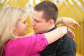 Young man and blonde in handcuff look each other — Stock Photo