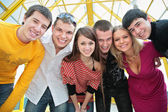Group of young friends look on you — Stock Photo