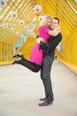 Boy hold girl on hand on footbridge — Stock Photo
