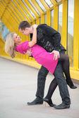 Boy embraces girl on footbridge — Photo