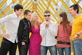 Group of young with microphone on footbridge — Photo