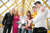 Group of young removes itself to video camera on footbridge — Stock Photo