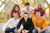 Group of young persons pose on footbridge — Stock Photo