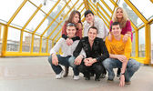 Group of young pose on footbridge — Stock Photo
