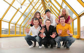 Group of young demonstrates open palms on footbridge — Stock Photo