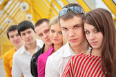 Group of serious young persons stand on footbridge — Stock Photo