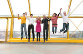 Group of young jump on footbridge — Stock Photo