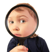 Child look through magnifier — Foto Stock
