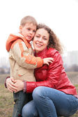Mother embraces son — Stock Photo