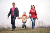 Family walk outdoor — Stock Photo