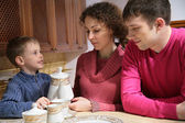Family at tea — Stock Photo