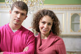 Young pair in interior kitchens — Stock Photo