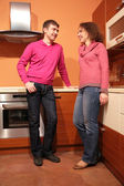 Young pair on kitchen — Stock Photo