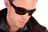 Close-up portrait of man in sunglasses — Stock Photo
