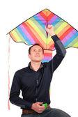 男子持有头上方的风筝 — 图库照片