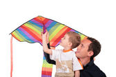 Man and boy hold kite above head — Stock Photo