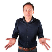 Surprised man makes helpless gesture — Stock Photo