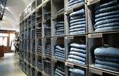 Cells with jeans in shop — Stock Photo