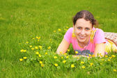 Young woman lies on grass — Stock Photo