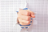Fist punch through paper — Stockfoto