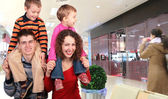 Family shoppers in store — Stock Photo