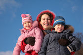 Mother and children outdoor in winter — Stock Photo