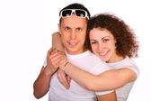 Girl embraces young man from behind — Stock Photo