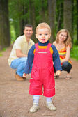 Child with parents in park — Stock Photo