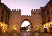 Towers with arches in street European city in evening — Stock Photo