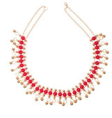 Golden necklace with red gems — Stok fotoğraf
