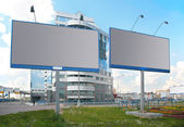 Publicity boards in city — Stock Photo