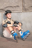 Roller sits under stone wall — Stock Photo