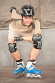 Roller under stone wall — Stock Photo