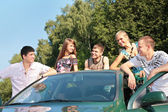 Group of friends with cad outdoor — Stock Photo