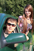 Gay and girl in car — Stock Photo