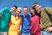 Group of friends in multicolor shirts — Stock Photo