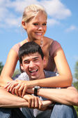 Girl embraces boy from back — Stock Photo