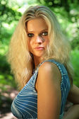 Young beautiful blonde in wood — Stock Photo