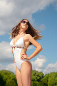 Girl in bathing suit with flying hair — Stock Photo