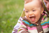 Closeup portrait of baby on nature — Stock Photo