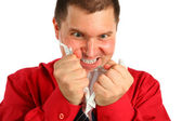 Irate man in red shirt rips sheet of paper — Stock Photo