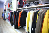Clothes on rack in shop — Stockfoto