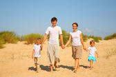 Family walk on sand — Stock Photo