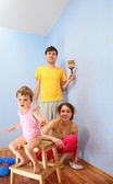 Parents with child repair room — Stock Photo