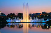Shined fountain on sunset — Stock Photo