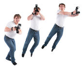 Young man goes with camera — Stock Photo