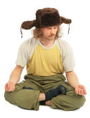 Meditating long-haired Russian man in cap with ear-flaps — Stock Photo